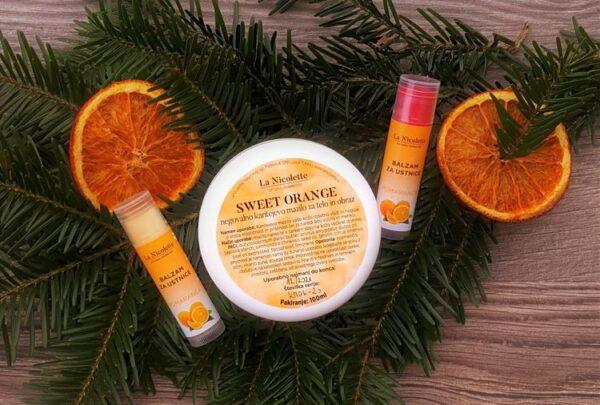 negovalni komplet z naravnim karitejevim mazilom in balzamom za ustnice z eteričnim oljem sladke pomaranče